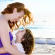 Daughter and mother hug on the Ibiza beach — Stock Photo #7315721