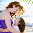 Daughter and mother hug on the Ibiza beach — Stock Photo #7315748