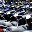 Royalty-Free Stock Photo: Bikes scooter pattern in renting store