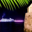 Ibiza night town cruise ship lights and tower — Stock Photo
