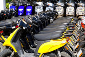 Scooter bikes in rental shop in a row — Stock Photo