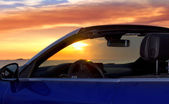 Ibiza sunset in Cala Conta from convertible — Stock Photo
