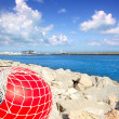 Stock Photo: Fishing buoy with net in formentera port