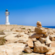 Barbaria formentera Lighthouse make a wish stones — Stock Photo #7325410