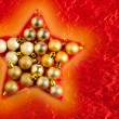 Christmas baubles in star shape on red — Stock Photo #7469910