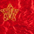 Christmas golden star of wire over red — 图库照片