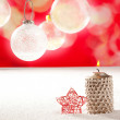 Christmas silver candle and red star on snow — Stock Photo
