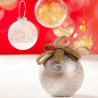 Christmas silver bauble with golden loop on snow — Stock Photo