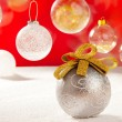Christmas silver bauble with golden loop on snow — Stock Photo #7470732