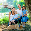 Family father mother kids and dog outdoor — Stock Photo