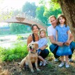 Family father mother kids and dog outdoor — Stock Photo #7470854