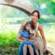 Daughter and mother with golden retriever — Stock Photo #7470865