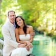 Couple of lovers in love in park river hug — Stock Photo