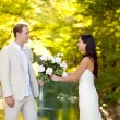 Couple in love with white roses bouquet — Foto Stock
