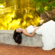 Woman relaxed in autumn golden forest river — Stock Photo