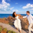 Couple in love running at the beach — Stock Photo