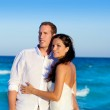 Couple in love hug in blue sea vacation — Stock Photo