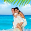Stock Photo: Couple in love piggyback playing in beach