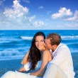 Royalty-Free Stock Photo: Couple in love sitting in blue beach