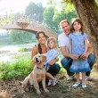 Stock Photo: Family in nature outdoor with dog