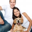 Couple in love puppy dog golden retriever — Stock Photo #7475753