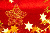 Estrela de natal ouro fio em glitter vermelho — Foto Stock