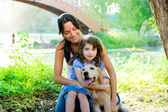 Daughter and mother with golden retriever — Stock Photo