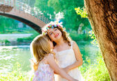 Kid girls playing in spring outdoor river park — Stock Photo