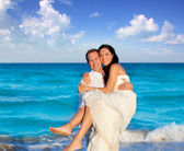 Couple in love hug in blue sea vacation — Foto Stock