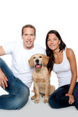 Couple in love puppy dog golden retriever — Stock Photo