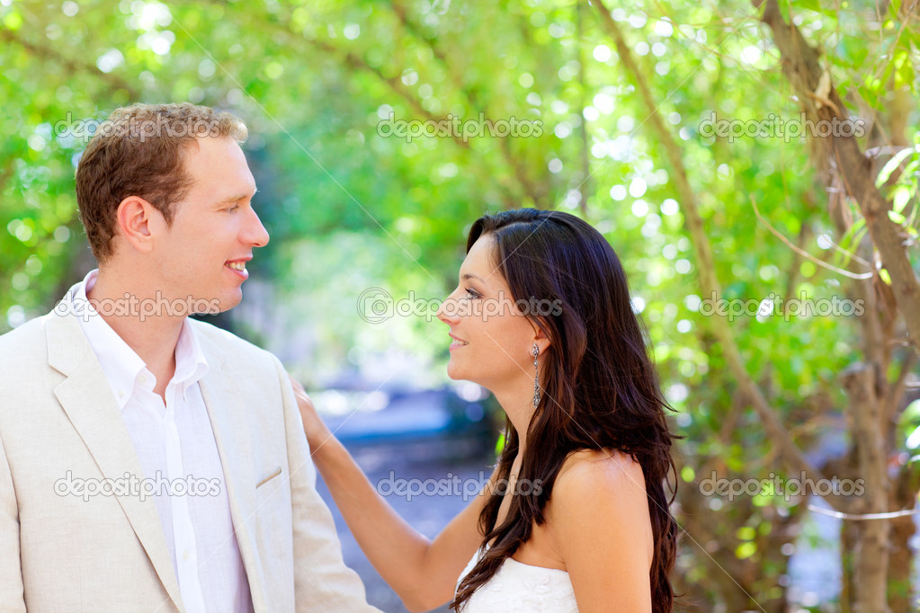 Bride just married couple in love at outdoor green park  Stock Photo #7471323