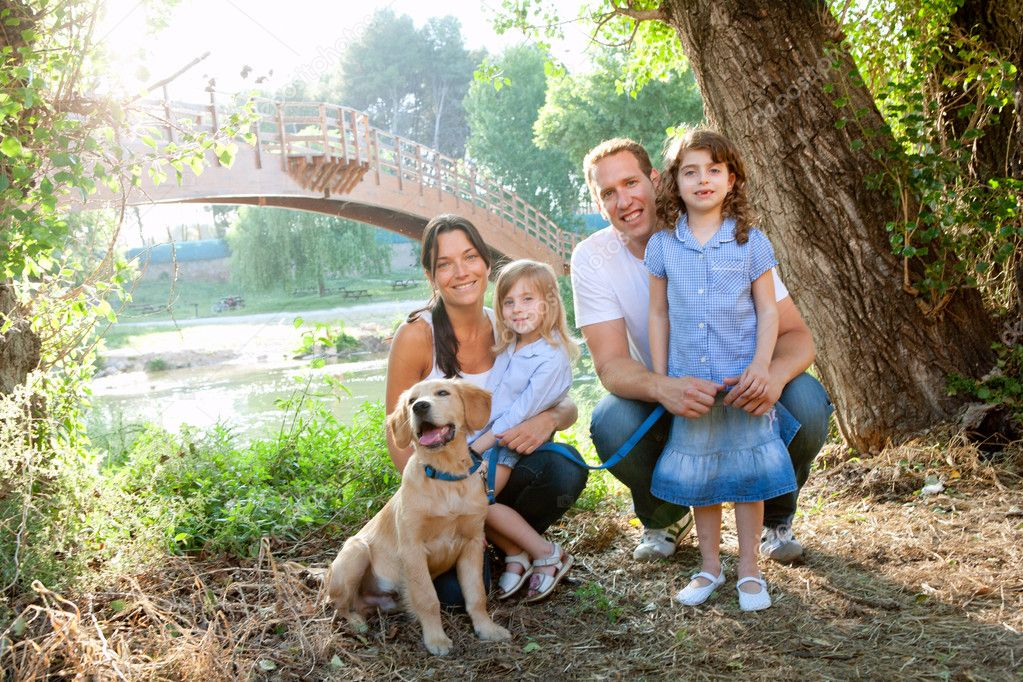 Family in nature outdoor with dog father mother and daughters — Stock Photo #7475537