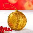 Christmas card of golden bauble berries on snow — Stock Photo