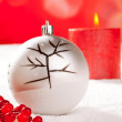 Christmas card of tree bauble and red candle - Stock Photo