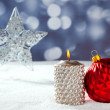 Christmas card of silver star bauble and candle — Stock Photo #7495974