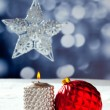 Royalty-Free Stock Photo: Christmas card of silver star bauble and candle
