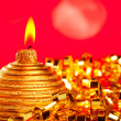Christmas card of golden bauble candle on tinsel — ストック写真