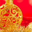 Christmas card golden bauble and tinsel — Stock Photo #7496153