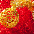 Christmas card golden bauble and tinsel — Stock Photo