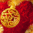 Christmas card golden bauble and tinsel — Stock Photo #7496422