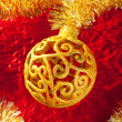 Christmas card golden bauble and tinsel — Stock Photo #7496444