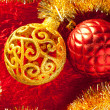 Christmas card golden bauble and tinsel on red — Stock Photo #7496479