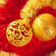 Christmas card golden bauble and tinsel on red — Stock Photo #7496518