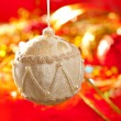 Christmas card of white velvet bauble on red — Stockfoto