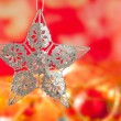 Christmas card of silver star and red blur — Stock Photo