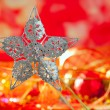 Christmas card of silver star and red blur - 图库照片