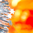Christmas tinsel stars silver blue on red — Stock Photo #7497540