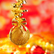Christmas tinsel golden glitter bauble loop - Stockfoto
