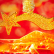 Christmas bethlehem comet gold star on red — Stock Photo