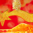Christmas bethlehem comet gold star on red - Stock Photo